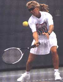 Woman hitting forehand